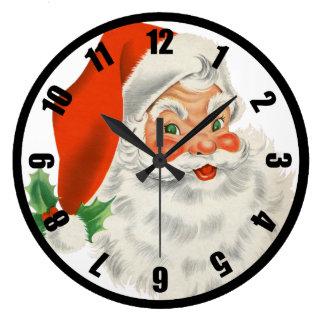 Le rétro père noël et houx grande horloge ronde