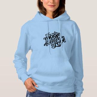Le sweatshirt à capuchon des femmes. avec dire
