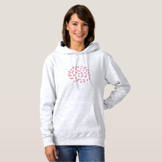 Le sweatshirt à capuchon des femmes avec le pois