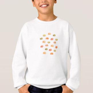 Le sweatshirt des enfants avec des citrouilles