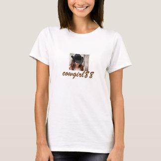 le T-shirt de la dame de cow-girl