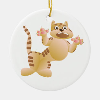 Le tigre, le chat grogne et menace des griffes de ornement rond en céramique
