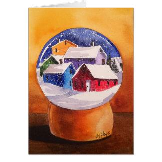Le village de globe de neige loge la carte