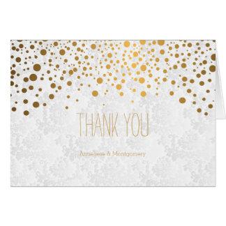 Les confettis élégants d'or pointillent la texture carte de correspondance