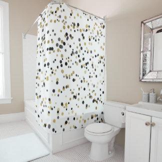 Les confettis noirs d'or blanc pointillent le rideaux de douche