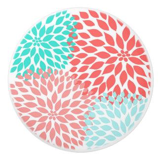 Les dahlias turquoises de corail autoguident le bouton de porte en céramique