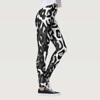 Les guêtres de guépard des femmes blanches noires leggings