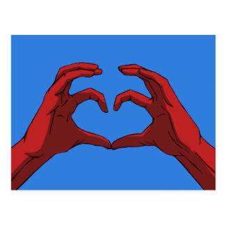 Les mains forment une carte postale de coeur