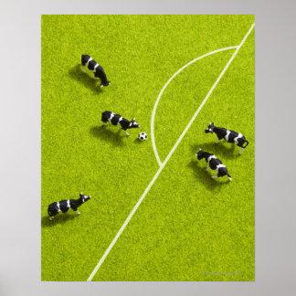 Les vaches jouant au football