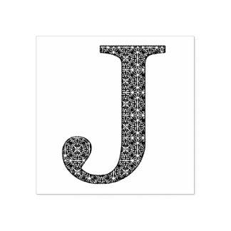 Lettre médiévale J de monogramme de damassé