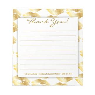 Lèvres d'or sur le blanc - bloc - notes fait sur blocs notes