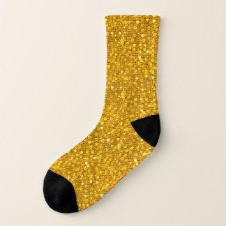 L'or d'amusement mesure les chaussettes de