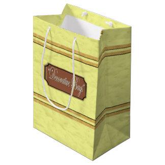 L'or de mousseline de soie raye le sac moyen de