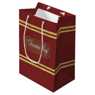 L'or marron ou rouge raye le sac moyen de cadeau