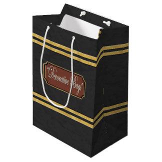 L'or noirâtre raye le sac moyen de cadeau