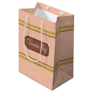 L'or rose raye le sac moyen de cadeau