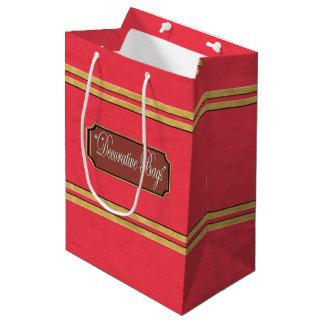 L'or rouge raye le sac moyen de cadeau