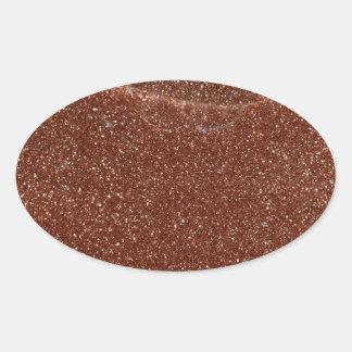 Macro photo de verre de Goldstone Sticker Ovale