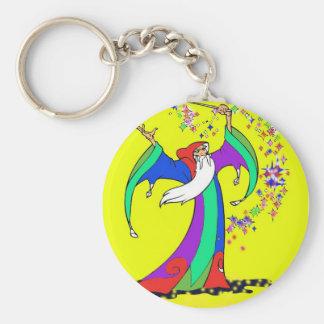 Magicien jetant des sorts magiques colorés avec la porte-clé rond