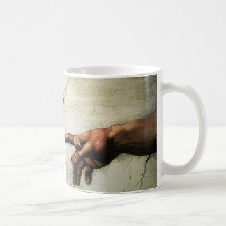 Main de tasse de Dieu
