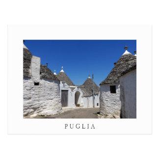 Maisons de Trulli en carte postale de blanc de la