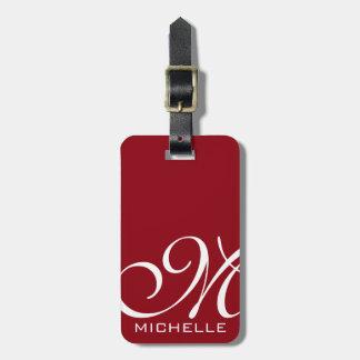 Manuscrit rouge décoré d'un monogramme étiquette à bagage