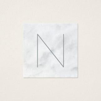 Marbre blanc décoré d'un monogramme professionnel carte de visite carré