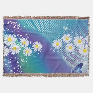 Marguerite fleur-sur la couverture bleue de jet