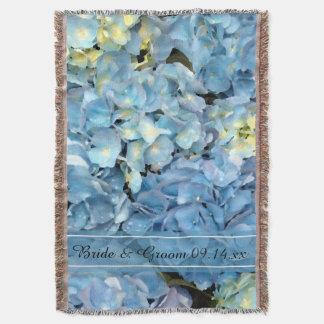 Mariage floral d'hortensia bleu couvre pied de lit
