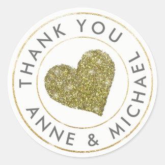 merci/faveur de mariage avec le coeur d'or sticker rond