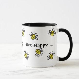 """Mignons heureux de """"abeille"""" gaffent la tasse"""