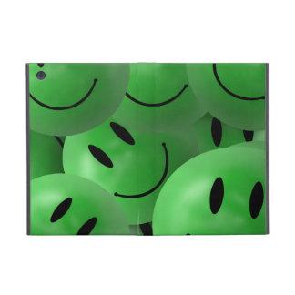 mini visages souriants verts d'iPad Coques iPad Mini