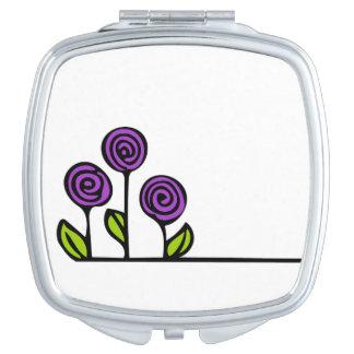 Miroir pourpre de cosmétique de fleur