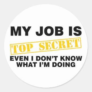 Mon travail est extrêmement secret sticker rond