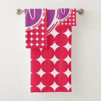 Monogramme pourpre et rouge de point de polka