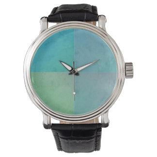 Montre Art moderne d'Aqua de motif géométrique turquoise