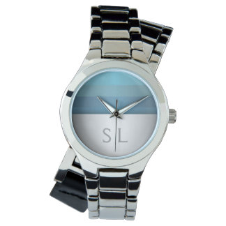 Montre Monogramme bleu de motif de rayures de turquoise