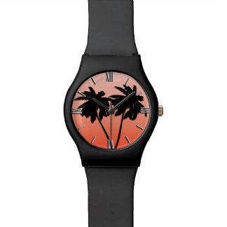 Montre Silhouette de palmier sur l'orange de coucher du
