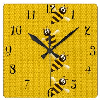 Motif abstrait jaune mignon d'abeilles de miel de horloge carrée