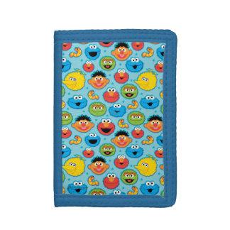 Motif de visages de Sesame Street sur le bleu
