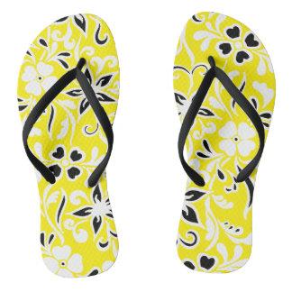 Motif floral noir et blanc jaune tongs