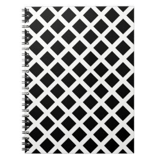 Motif noir et blanc d'illusion optique de grille carnet à spirale
