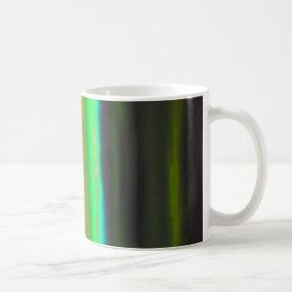 Mug Brume verte au néon au-dessus des terres noires