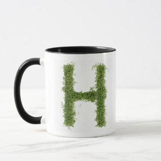 """Mug Marquez avec des lettres """"H"""" en cresson sur"""