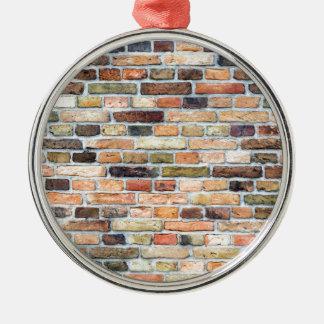 Mur de briques avec de diverses couleurs ornement rond argenté