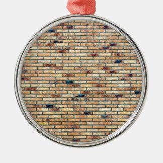 Mur de briques avec plusieurs couleurs ornement rond argenté