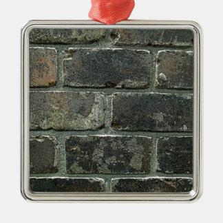 Mur de briques ornement carré argenté