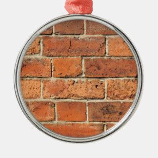Mur de briques rouge ornement rond argenté