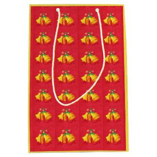 Noël Bells jaune sur le sac rouge de cadeau