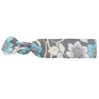 Noir, bleu et crème floraux élastiques pour cheveux